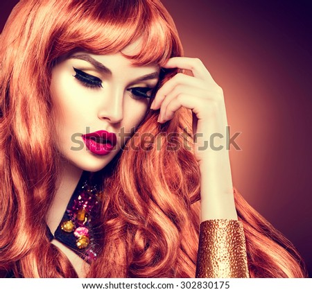 Beauty Woman Portrait. Healthy Long Curly Red Hair and perfect holiday make up. Beautiful Glamorous Girl face closeup - stock photo