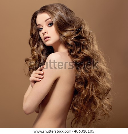 Beauty Woman Portrait. Healthy Long Hair and perfect holiday make up.