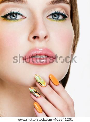 Beauty Woman Portrait. Professional Makeup and Manicure. Rainbow colors. - stock photo
