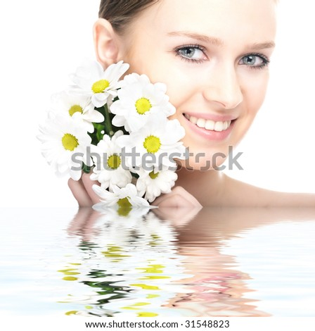 beauty woman portrait with camomile flower on white background - stock photo