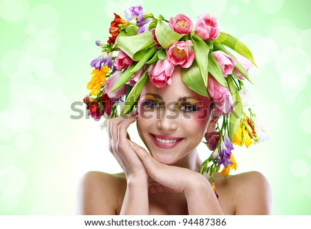beauty woman portrait with wreath from flowers on head green background - stock photo