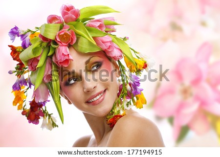 beauty woman portrait with wreath from flowers on head over white background - stock photo