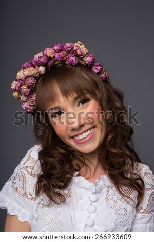 beauty woman portrait with wreath of flowers studio shot - stock photo