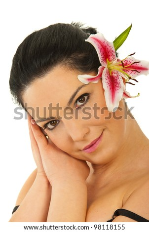 Beauty woman resting face on hands and holding a pink lily in her hair isolated on white background