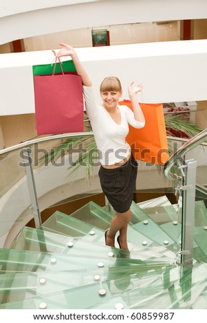 beauty woman shopping in mall with colored bag