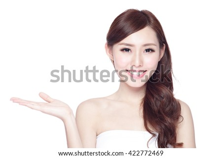 Beauty woman show something to you with charming smile, health skin, teeth and hair isolated on white background, asian beauty - stock photo