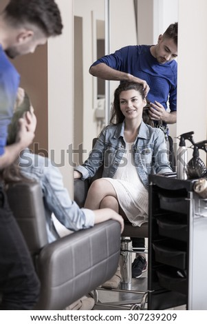 Beauty woman sitting on the chair at hair salon - stock photo