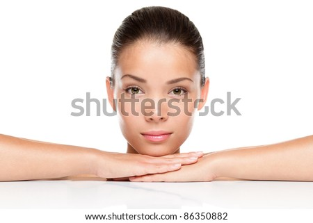Beauty. Woman skin care concept. Portrait of beautiful mixed race Asian Caucasian female beauty model isolated on white background
