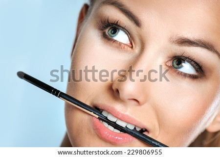 Beauty Woman. Skincare concept. Beauty Face. Beauty concept.Makeup Applying. Professional Make-up. - stock photo