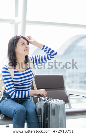 beauty woman smile happily and look something in airport, asian