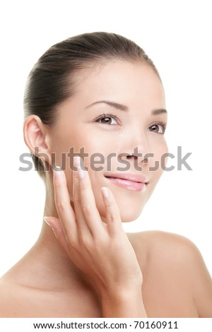 Beauty woman smiling applying cream. Beauty portrait of beautiful mixed-race Asian / Caucasian female model isolated on white background looking away. - stock photo