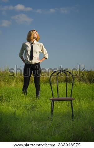Beauty woman standing at the field and looking in expanse