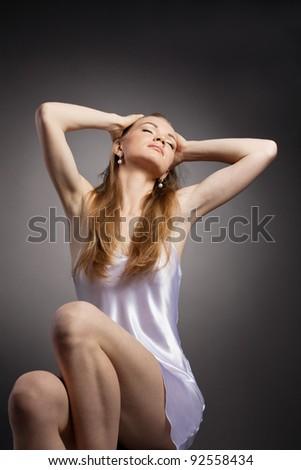Beauty woman studio portrait look at light - stock photo