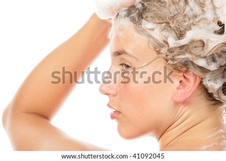 Beauty woman washing hair isolated on white background - stock photo