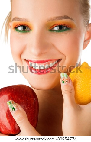 beauty woman with apple and lemon in hand