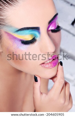 Beauty woman with art makeup