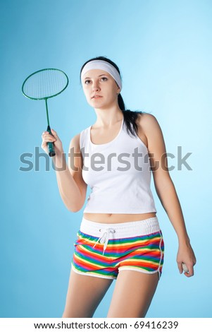 beauty woman with badminton racket isolated on blue - stock photo