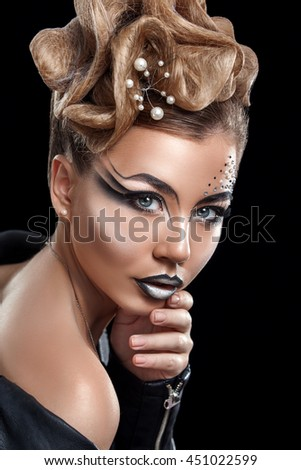 Beauty woman with beautiful make-up color . Blond hair , raised hair , jewelry on his neck , clean skin , beautiful face . Portrait shot in studio on a dark background . - stock photo