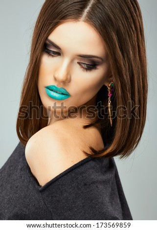 Beauty woman with blue lips, streaight hair. Young model.