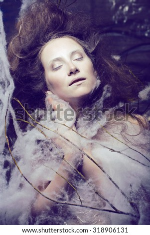 beauty woman with creative make up like cocoon, halloween celebration creepy