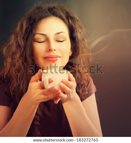 Beauty Woman With Cup of Coffee or Tea. Happy Girl with hot beverage  - stock photo
