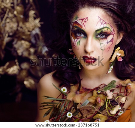 beauty woman with face art and jewelry from flowers orchids close up, creative makeup - stock photo