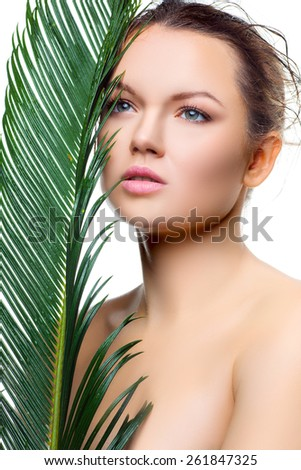 Beauty woman with fresh tropical palm leaf. Health concept. Professional Makeup and hairstyle - stock photo