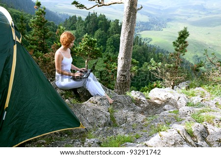 beauty woman with laptop on nature - stock photo