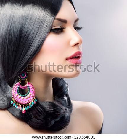 Beauty Woman With Long Black Hair. Hairstyle. Beautiful Model Girl Portrait. Earrings. Accessory - stock photo