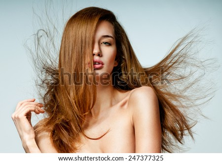Beauty Woman with  Long Brown Hair.Gorgeous Hair.