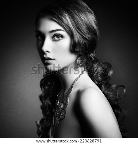 Beauty woman with long curly hair. Beautiful girl with elegant hairstyle. Fashion photo. Black and white - stock photo