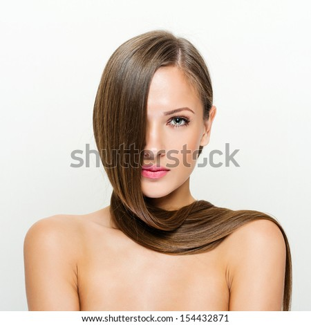 Beauty Woman with Long Healthy and Shiny Smooth Brown Hair.