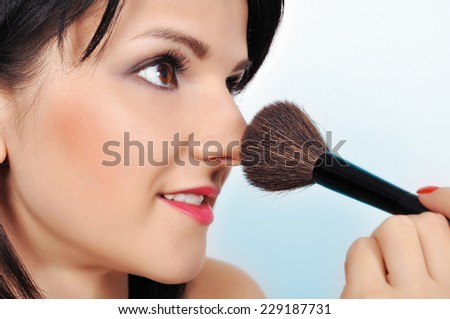Beauty woman with makeup brush, close up