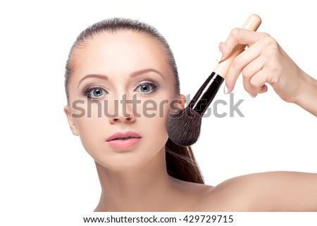 Beauty woman with Makeup Brushe. Natural Make-up for Brunette girl with blue Eyes. Beautiful Face. Makeover. Perfect Skin. Applying Makeup - stock photo