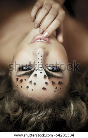 Beauty woman with makeup in snow leopard style. Fashion makeup model face. Luxury girl with trendy make up  - stock photo
