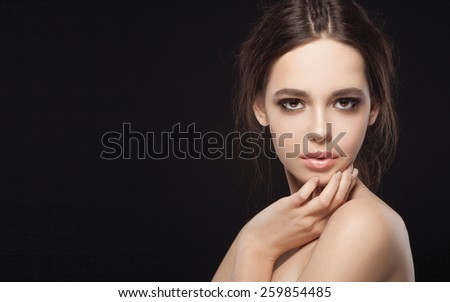 Beauty Woman with Perfect Makeup. Beautiful Professional Make-up. Beauty Girl's Face isolated on Black background. Glamorous Woman - stock photo
