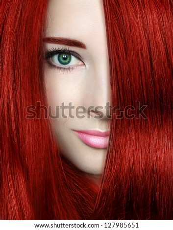 Beauty woman with red bright hair. Closeup portrait of style female model - stock photo