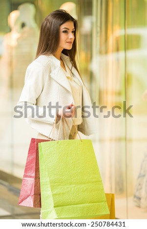 Beauty woman with shopping bags in shopping mall. Sales. Shopping Center. - stock photo