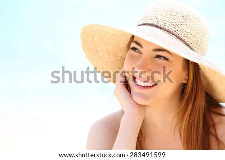 Beauty woman with white teeth smile looking sideways - stock photo