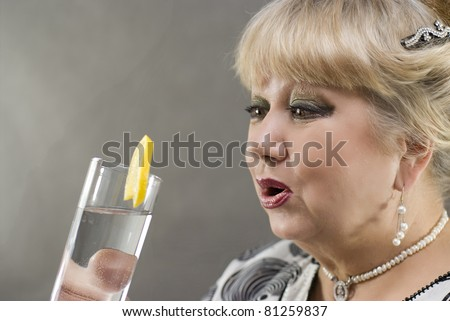 beauty woman wonder face with open mouth on grey background - stock photo