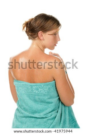 Beauty woman wrapped towel isolated on white background - stock photo