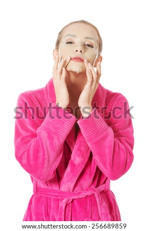 Beauty women getting facial mask - stock photo