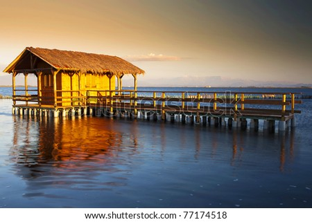 beauty wood home in water on the sunset