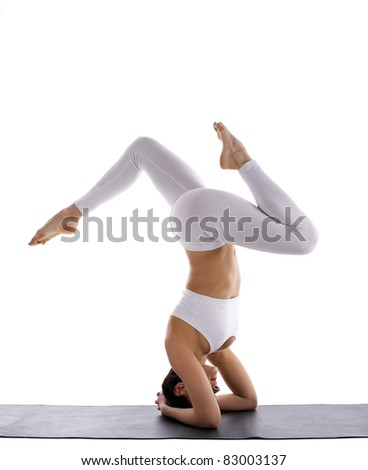 beauty yoga woman in white stand  on head - stock photo