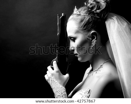 beauty young bride in white dress holding the old gun - stock photo