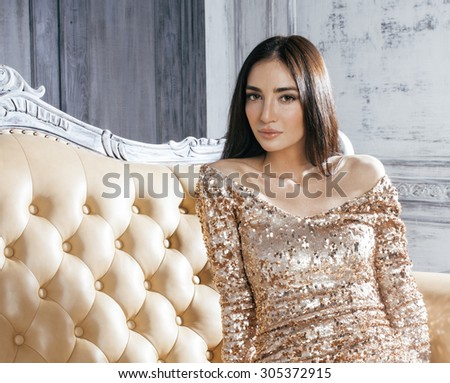 beauty young brunette woman in luxury home interior, fairy bedroom grey stylish close up - stock photo