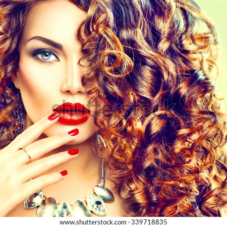 Beauty young brunette woman with curly hair, perfect make up and manicure. Permed hair. Glamour lady, Beauty Girl. Beautiful Woman Portrait. Wavy Hair - stock photo