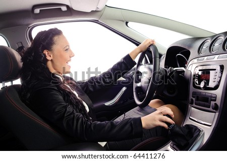 beauty young businesswoman drive the car.you can set any background in place of white windows