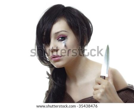 beauty young crying woman with knife in her hand - stock photo