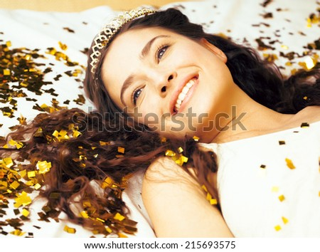 beauty young girl in gold confetti and tiara, little princess celebration close up - stock photo